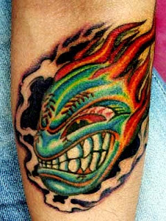 flame tattoo on inner forearm