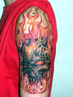 Red skull tattoo on arm picture