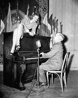President Harry Truman plays piano to Lauren Bacall