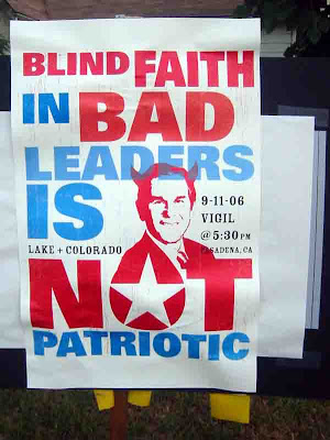 Blind Faith in Bad Leaders is Not Patriotic - picture of George W. Bush with horns - anti-war Rally - Pasadena CA 9/11/2006