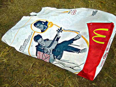a hip young cellist on a discarded McDonald's bag