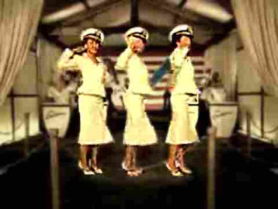 Christina Aguilera - still from Candyman video, like Andrews Sisters