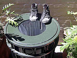 old shoes on a trash can - Old Pasadena CA