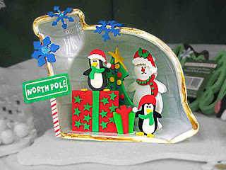 Christmas Penguins with Polar Bear in Igloo and sign saying North Pole