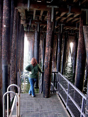 Avila Beach California under the pier - Leslie contemplates her ocean