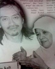 Salmi Manja dan anaknya, Helmy