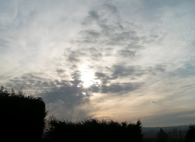 photograph of sunburst through cloud winter day