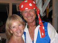 Catamaran GODIV - Dave and Marci at Pirate Party, St. Thomas - (Photo ©2009 - Paradise Connections)