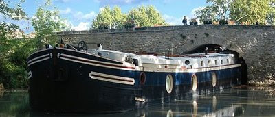French Hotel Barge ALEGRIA. Cruise the Canal du Midi in the south of France. Contact ParadiseConnections.com