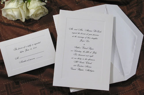 A beautiful unadorned panel is embossed in a soft white vellum invitation