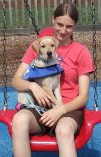 Picture of Toby & I in the park on a swing - Toby's in my lap... and is only 9 weeks!