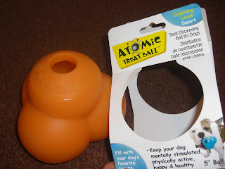 Photo of Rudy's new toy beside the packaging it came in