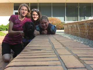 Picture taken from a camera stand - picture of me, My friend, my sister, and Sparkie beside the water fountain