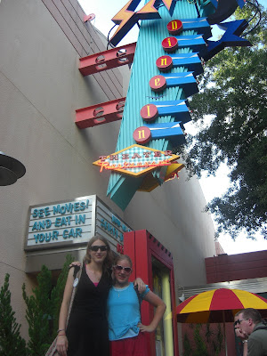 Photo of my sister & I Standing below the Sci Fi drive in restaurant