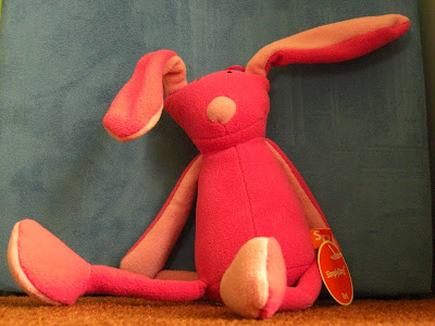 Photo of Rudy's new toy (with tags still on), it's a very cute pink bunny!
