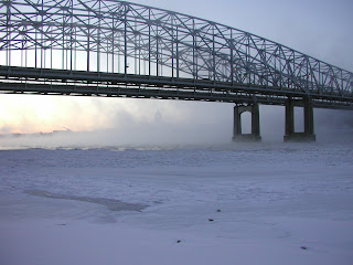 bridge over the Missouri River in snow, ice and fog
