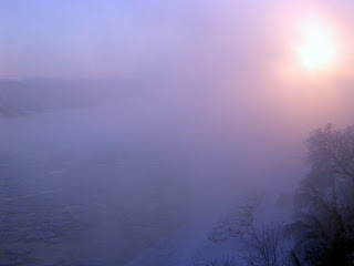 sunrise over the icy Missouri River