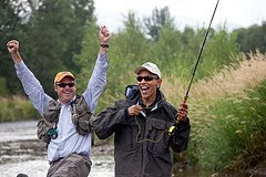 Local fishing guide Dan Vermillion reacts as President Barack Obama almost hooks a trout