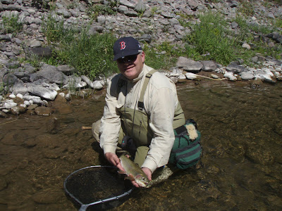 John Corrigan with a Montana trout. Photo courtesy of J. Corrigan