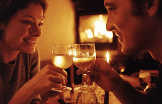 couple enjoying candle light dinner