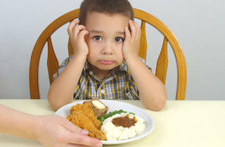 boy with dinner plate