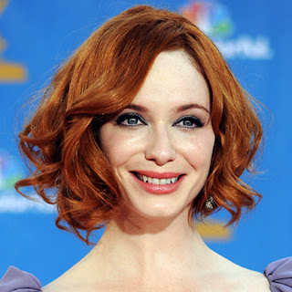 christina hendricks wearing lancome corset lipstick at emmys