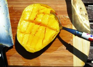 Coconut lime recipes by rachel rappaport how to cut up a mango sixth place your spoon between the skin and the flesh and scoop out the cubes depending on how big your mango is you may be able to do this in one try ccuart Gallery