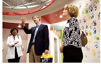 President Mary Sue Coleman (right) and Vice President of Student Affairs E. Royster Harper (left) meet with Grady Burnett, former director of online sales at Google Ann Arbor, during a tour of the company's Ann Arbor office.
