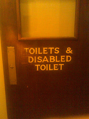 An internal door, signed toilets and disabled toilet