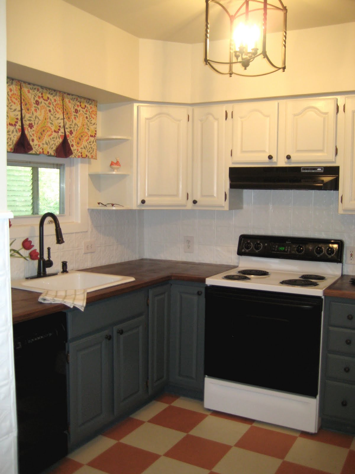 Cream Kitchen Cabinets with Black Appliances