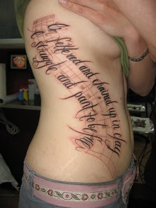 Letter Tattoo with Musical Notes on Female Side Body