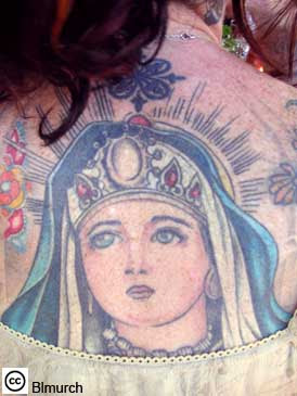 Religious Tattoo Design on Female Back