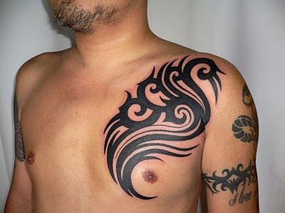 Tribal Tattoo on Male Chest and Arm