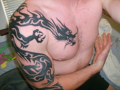 "Dragon Tattoo design on Arms and Chest. RANDOM TATTOO QUOTE: ""Not one great"