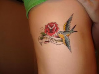 rose tattoo with bird tattoo design