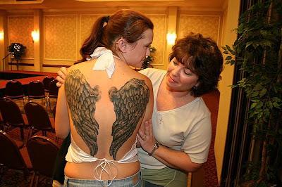 Tattooed Women Wings Tattoo on Back Body