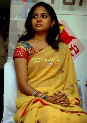 Singer Sunitha in yellow saree with designer blouse