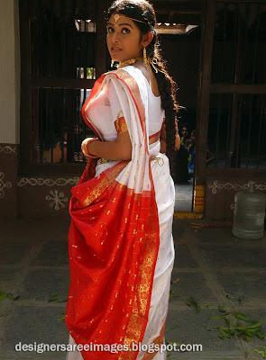 Actress Prathishta in White Colour Bridal Silk Saree