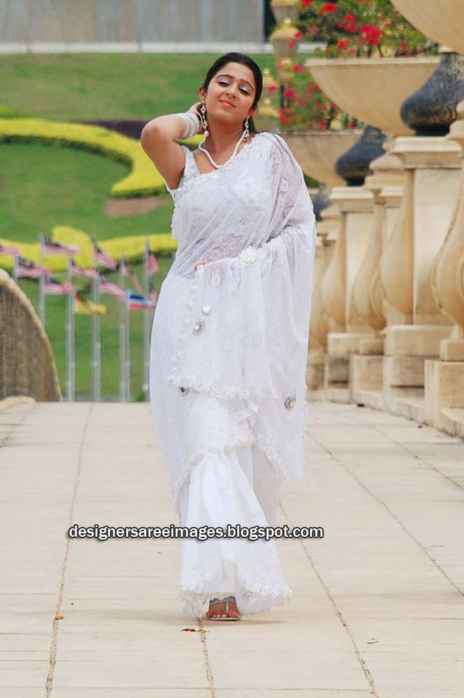 Actress Charmi in White Saree with Sleeveless Designer Sari Blouse