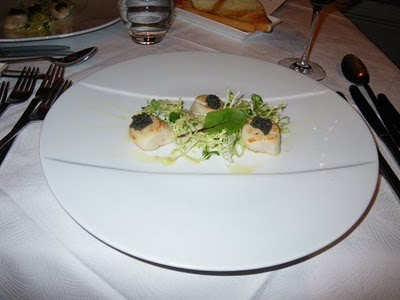 Scallop with mixed greens and caviar salad