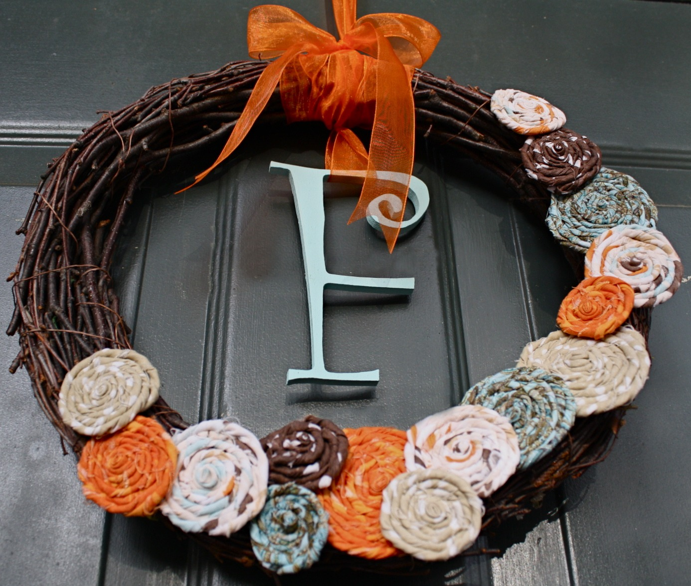 Things made an adorable Fall Wreath  I love the rolled fabric flowersFall Craft Ideas For The Home