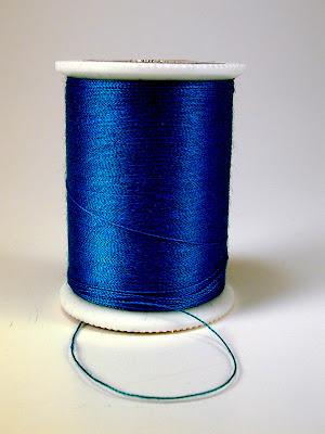 Spool of blue thread themes
