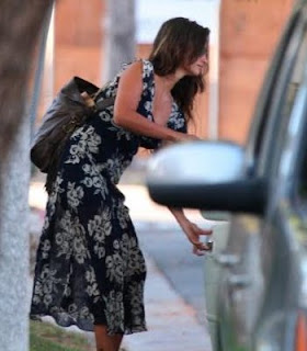 Penelope Cruz seen getting into a vehicle.  Ergo, she must be pregnant.