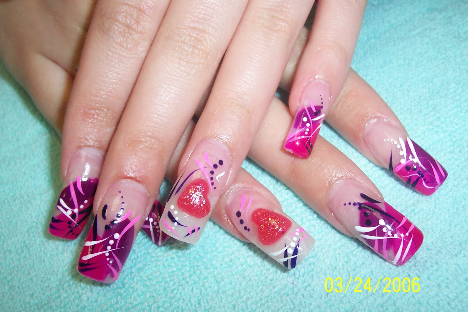 Great looking acrylic nail design with an attractive floral design