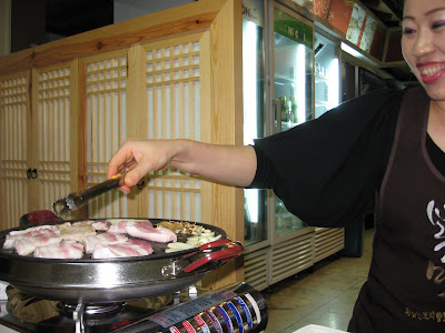Chinese girl serving samgyupsal in Insa-dong