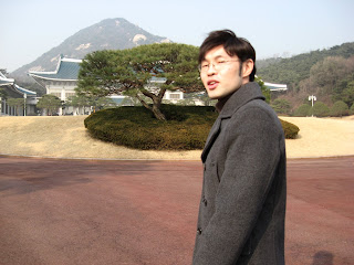 Mr Lee in front of main building