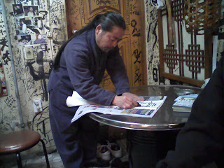 Andy's makkuli guy doing calligraphy