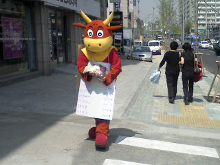sandwich board cow for galbi restaurant
