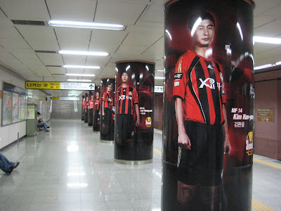 Subway platform pillars with FC Seoul players on them