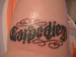 Ambigram Tattoo of the words Carpe Diem